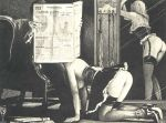 2_girls ass black_and_white fellatio high_heels newspaper paper sitting stockings tied whip